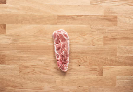 Pig meat on wooden table
