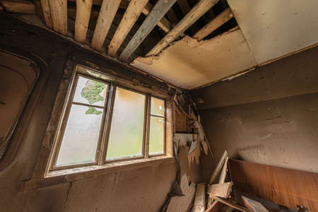 A room in a wooden house after lightning strike and subsequent fire. 写真素材