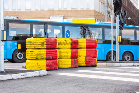Tyre barriers protecting road works.