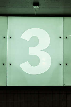 The number three, 3, on a glass wall. Stockfoto