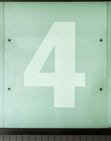 The number four, 4, on a glass wall.