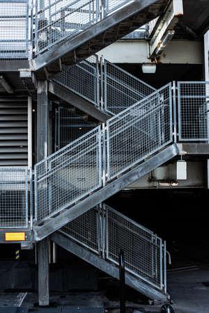 Metal stairs between three floors of a parking house.