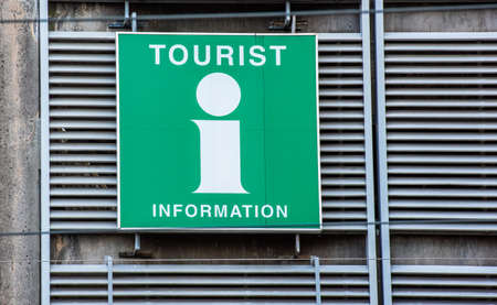 Tourist information sign on the wall of a parking garage.