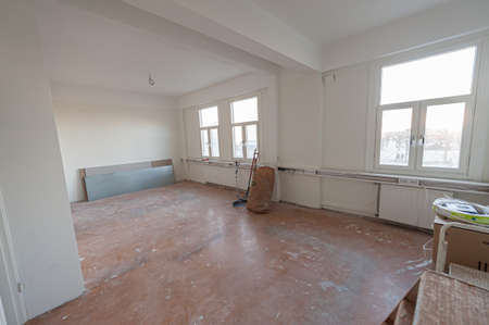 Empty office during renovation. White painted walls.