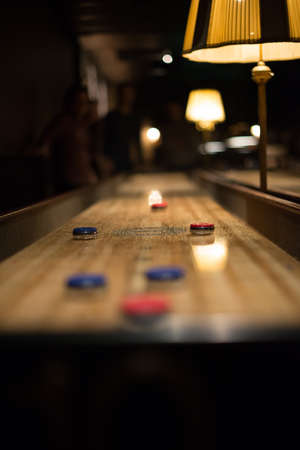 Playing the game of shuflleboard.