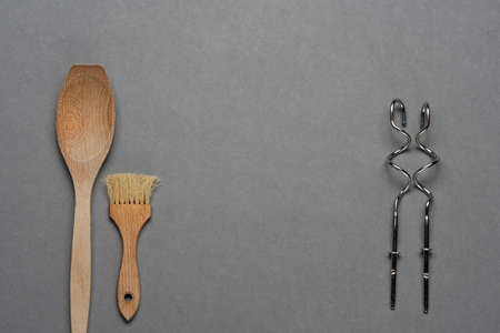 Wooden spoon and kneading hooks on grey background 写真素材