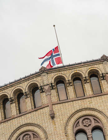 Oslo, Norway - July 24 2011: Flag flying at half-staff at the Parliament of Norway Building, Stortinget. Redakční