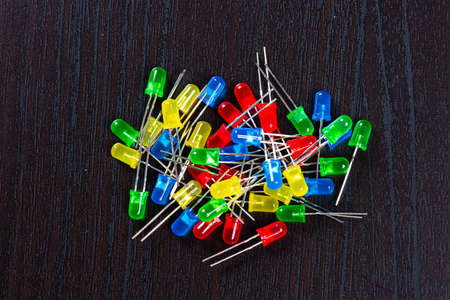 Assortment of yellow, red, green and blue LED diodes in a black table. Reklamní fotografie