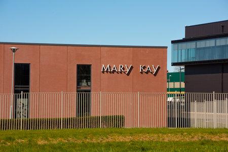 Gothenburg, Sweden - April 25 2020: Logo of Mary Kay on the wall of a logistics facility. Редакционное