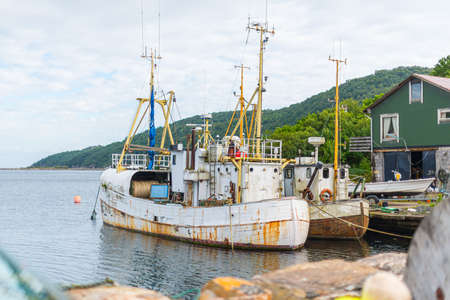 Lindesnes, Norway - June 27 2016: Two decomissioned fishing vessels laid up before scrapping.