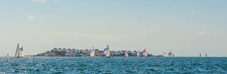 Tjörn, Sweden - August 17 2013: Tjörn Runt is an annual long distance sailing competition that takes place around the island of Tjörn. View from Rönnäng with Åstol island in the background.