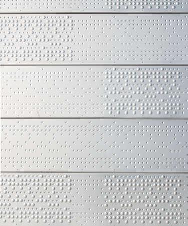 Braille-like texture on metal plates.