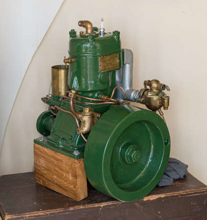 Lindesnes, Norway – april 4 2013:Vintage Marna boat engine mounted as a display piece