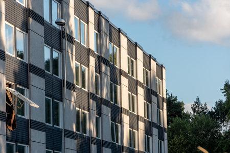 Gothenburg, Sweden - August 24 2020: Concrete apartment complex by a forest