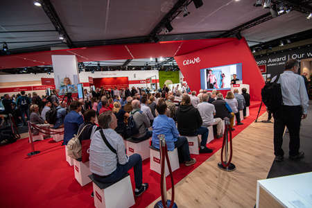 Cologne, Germany - september 27 2018: Visitors listening to a presentation at Photokina.