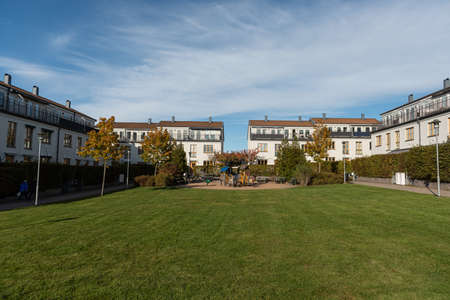 Mölndal, Sweden - October 18 2020: Small park and playground by three storey apartment houses