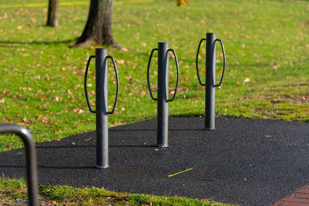 three metal poles used for bicycle parking