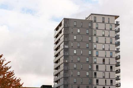 Eleven storey high grey apartment building
