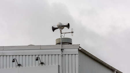 Civil protection alarm siren on the roof of a building