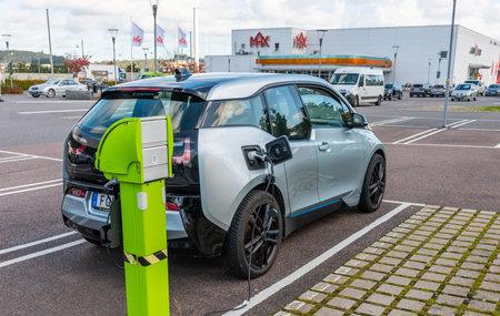 Gothenburg, Sweden - October 09 2020: BMW i3 hybrid car charging at a charging station