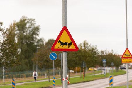 Mölndal, Sweden - October 24 2020: Warning signs with trotting horse 免版税图像 - 157892694