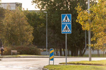 Mölndal, Sweden - October 24 2020: Sign of bicycle crossing with female pedestrian crossing sign near Åby