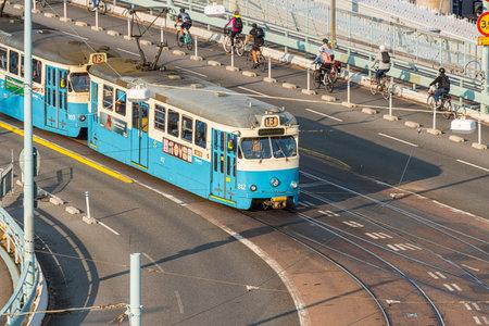 Gothenburg, Sweden - september 10 2020: Tram on line 13 on its way down Göta Älv bridge 新闻类图片
