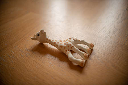 Toy giraffe on a wooden table