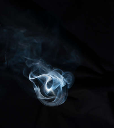 Blue smoke on black background. 免版税图像