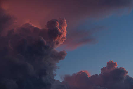 Majestic pink clouds in a stormy sky