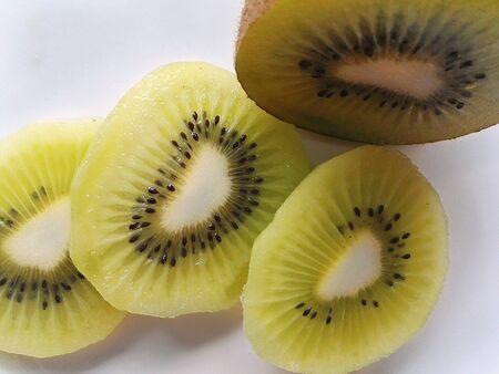 Kivi slice green on white plate on table