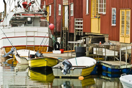 anchoring: Motorboats anchoring in a crowded tiny dock Stock Photo