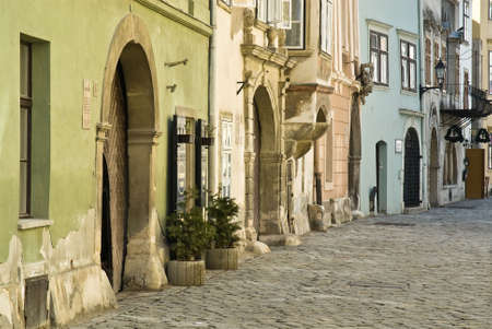 old building facades: Colorful row of old building facades on a charming quiet street Stock Photo