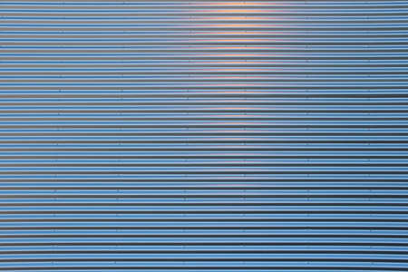 corrugated steel: Blue Corrugated Steel Plate with warm reflex Stock Photo