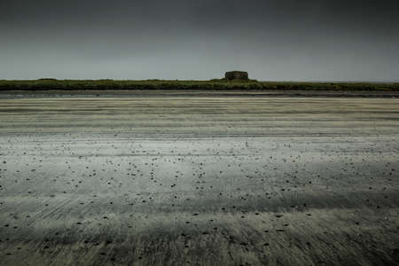 deserted: Deserted beach in the Arctic. The disturbing gray landscape. Stock Photo
