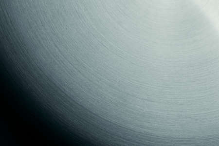 semicircular: The steel surface with the semicircular lines. The gradient background. Stock Photo