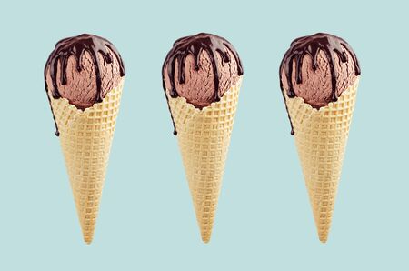 Set of three brown ice cream in crisp waffle cones with chocolate sauce on pastel green background, mock up.