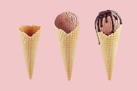 Set of chocolate ice cream cones in  waffle cone - empty, brown ice cream, with chocolate sauce on pink color.