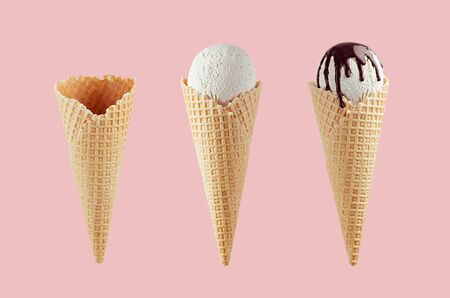 Set of different ice cream cones in waffle cone - empty, white ice cream, with chocolate sauce on  pink background. 스톡 콘텐츠