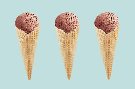 Set of three chocolate ice cream in crisp waffle cones on pastel green background, mock up for design. 스톡 콘텐츠