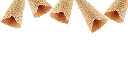Empty waffle ice cream cones as decorative frame isolated on white background.