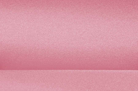 Pastel pink glittering glowing metallic background as empty space with wall.