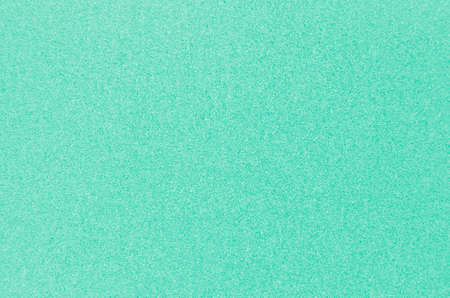 Green mint color glitter texture as background.