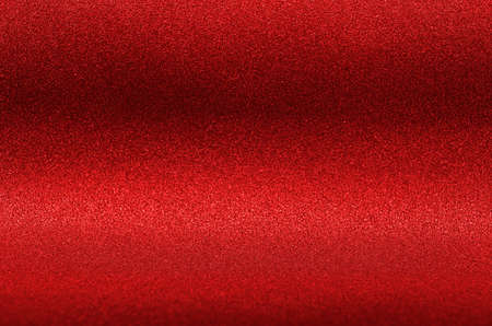 Rich red glitter texture as background.