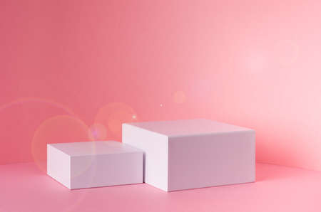 White square podiums for presentation cosmetic, accessories and produce on sunny bright pastel pink background with sun flare, copy space. Fashion fresh spring showcase.