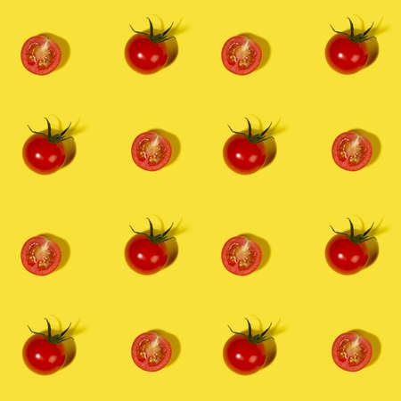 Vegetable colorful seamless pattern - ripe cherry tomato whole and halves with shadow on yellow background top view, square.