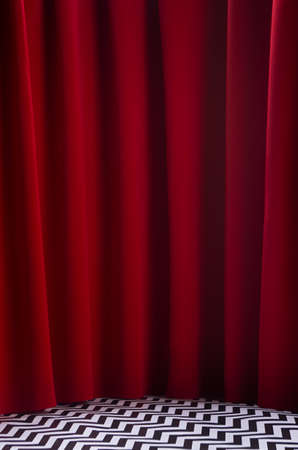 Twin peaks scene with red velvet curtain and black and white tile on floor, vertical. Theater blank stage for presentation. 免版税图像