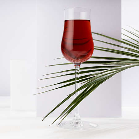 Red porto wine in luxury high glass with green palm leaf in hard light with shadow in soft light white abstract interior with geometric surfaces in minimal style, square.