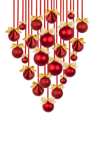 Rich bunch or upside down Christmas tree of shiny red balls with golden bows hanging on ribbons isolated on white background. Christmas background art for design of poster, flyer, card, brochure. 免版税图像