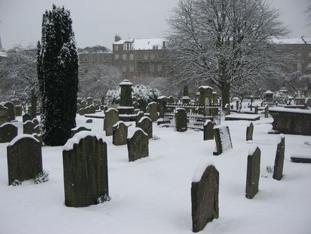 Snow covered cemetery photo